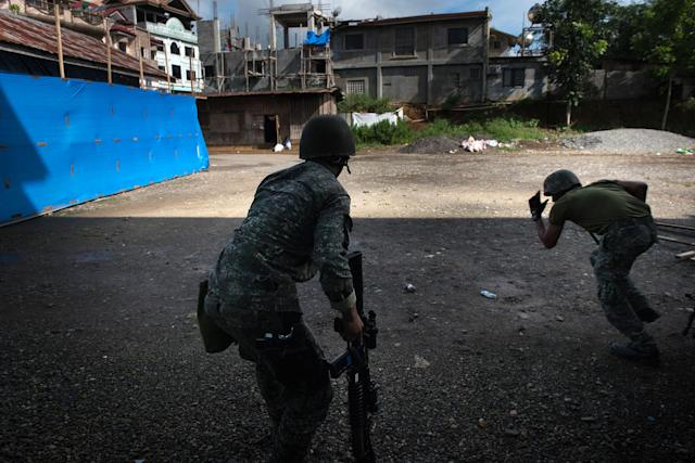 <p>Filipino soldiers engage in a firefight with ISIS-linked militants, on May 30, 2017 in Marawi city, southern Philippines. Philippine government troops are battling their way as they inch towards the city center where ISIS-linked militants have been holed for nearly a week. (Jes Aznar/Getty Images) </p>