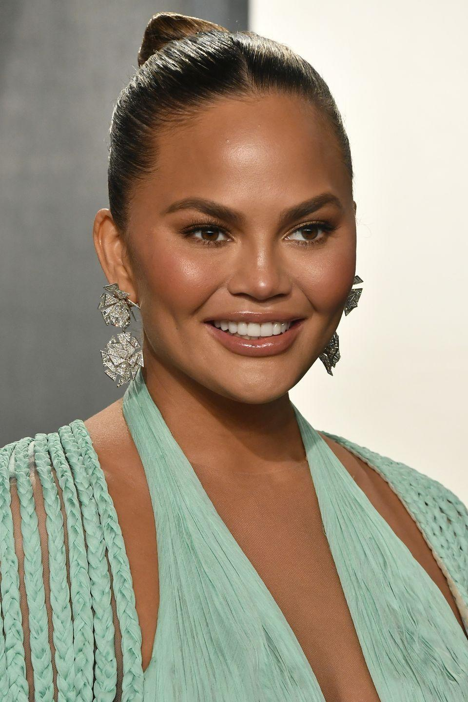 "<p>Chrissy Teigen has always taken a candid, open approach to social media, and cosmetic surgery isn't a conversation she has shied away from.</p><p>She recently revealed that she had undergone further surgery to remove her breast implants, posting a candid photo on <a href=""https://www.instagram.com/p/CMV8P81Bwp5/"" rel=""nofollow noopener"" target=""_blank"" data-ylk=""slk:Instagram"" class=""link rapid-noclick-resp"">Instagram</a> about the experience. While her trademark full cheeks, she assures us, are her own, she has had liposuction on her armpits too, about which she has ""no regrets, except it came back"".</p>"