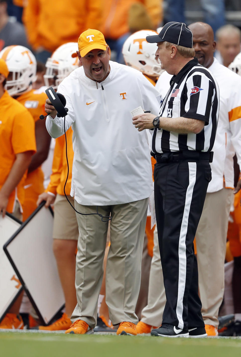 Tennessee head coach Jeremy Pruitt yells at an official during the first half of an NCAA college football game against Mississippi State, Saturday, Oct. 12, 2019, in Knoxville, Tenn. (AP Photo/Wade Payne)