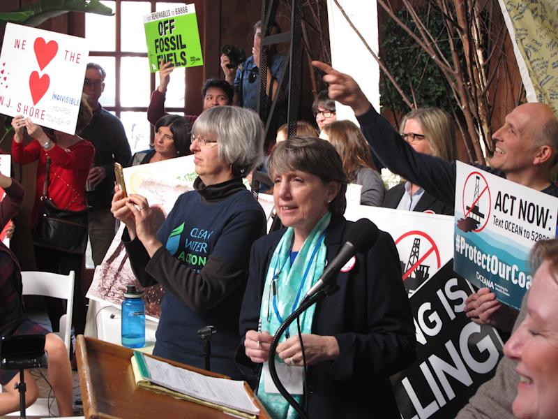 Cindy Zipf of the Clean Ocean Action environmental group, speaks against President Donald Trump's plan to allow offshore oil and gas drilling along most of the nation's coastline at a hearing Wednesday Feb. 14, 2018 in Hamilton, N.J. The hearing was one of many held by environmentalists and opponents of the drilling plan around the country before information sessions about the drilling plan held by the federal Bureau of Ocean Energy Management. (AP Photo/Wayne Parry)