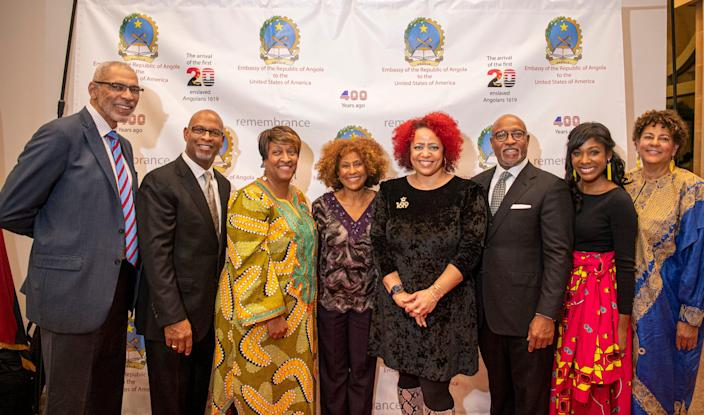 The Tucker family poses with Nikole Hannah-Jones, Creator of the New York Times 1619 project during an event honoring the 400th year anniversary of the first 20+ Angolans to arrive in America on Monday, Dec. 16, 2019 at the Smithsonian Museum of African Art.  The Tucker family of Hampton, Va., including Wanda Tucker, the main subject of USA TODAY's 1619 project, was honored by the Embassy of Angola on Dec. 16, 2019 during a program marking the 400th year since the arrival of enslaved Angolan people (including Tucker ancestors) to what is now Virginia. The program took place at the Smithsonian Museum of African Art in Washington.