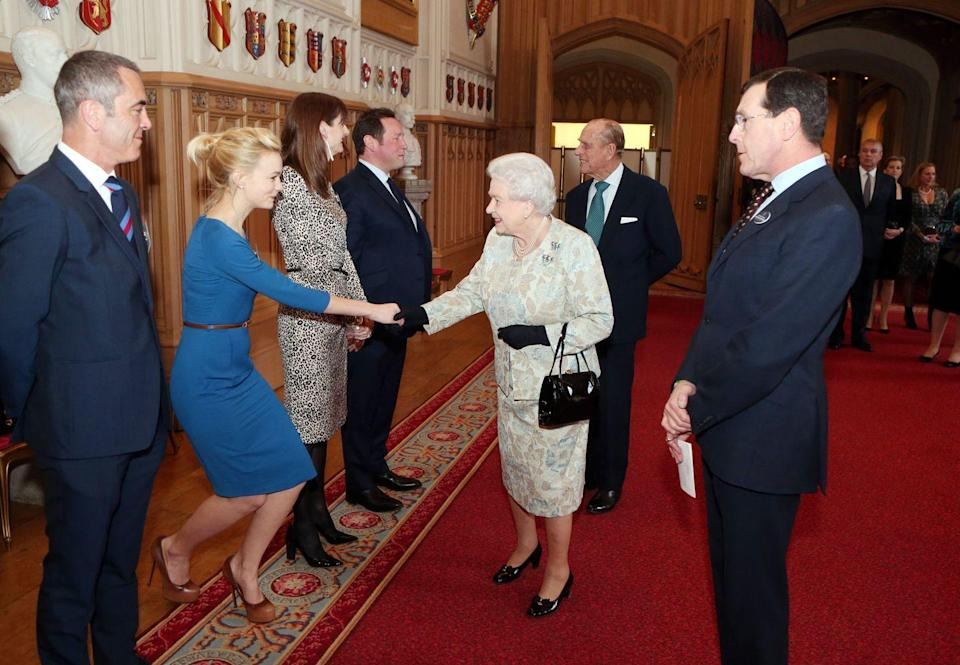 <p>Nothing to see here, just another actress wearing another dark blue dress to meet the Queen. Carey Mulligan's belted number is on the more casual side of the spectrum.</p>