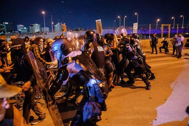 PHOTO: Protesters clash with police after a tear-gas canister was lobbed into the crowd gathered on Highway 90 in New Orleans to protest the death of George Floyd, June 3, 2020. (J Keaton/REX via Shutterstock)