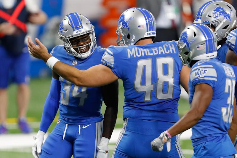 Lions cornerback Tony McRae, left, celebrates with long snapper Don Muhlbach after making a good special teams play during the first quarter on Sunday, Sept. 13, 2020, at Ford Field.