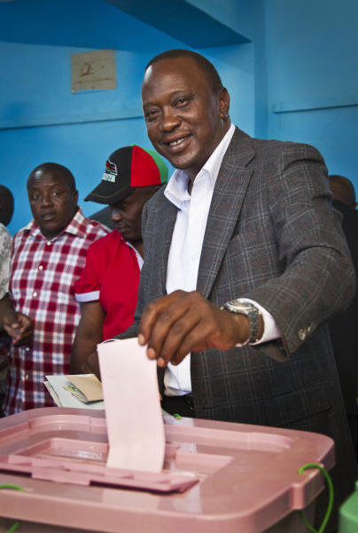 Kenyan Presidential candidate Uhuru Kenyatta casts his vote at the Mutomo primary school near Gatundu, north of Nairobi, in Kenya Monday, March 4, 2013. Five years after more than 1,000 people were killed in election-related violence, Kenyans went to the polls on Monday to begin casting votes in a nationwide election seen as the country's most important - and complicated - in its 50-year history. (AP Photo/Ben Curtis)