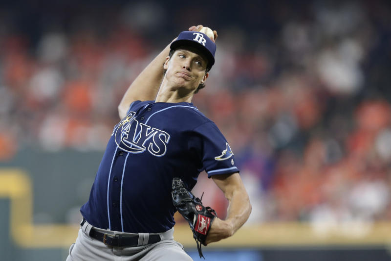 Tampa Bay Rays starting pitcher Tyler Glasnow (20) delivers a pitch against the Houston Astros in the first inning during Game 1 of a best-of-five American League Division Series baseball game in Houston, Friday, Oct. 4, 2019. (AP Photo/Michael Wyke)