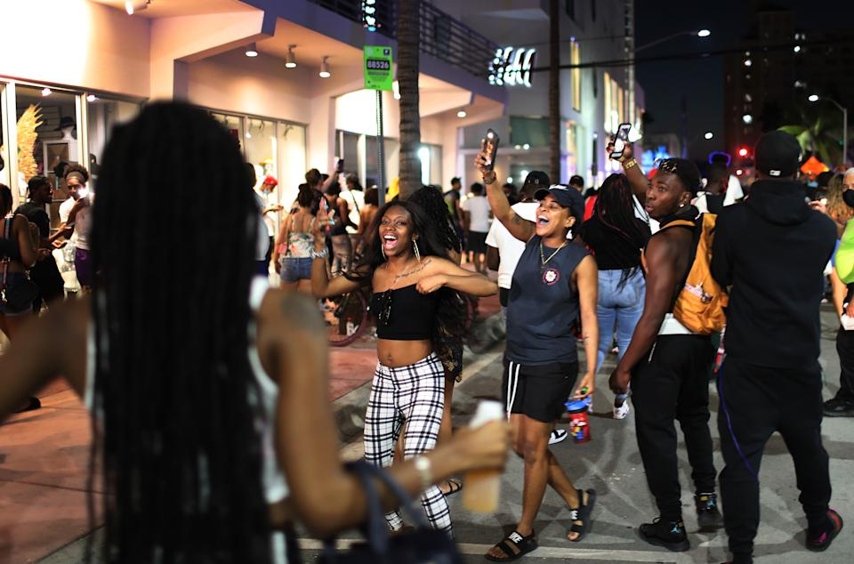 MIAMI BEACH, FLORIDA - MARCH 21: People leave the area as an 8pm curfew goes into effect on March 21, 2021 in Miami Beach, Florida. College students have arrived in the South Florida area for the annual spring break ritual, prompting city officials to impose an 8pm to 6am curfew as the coronavirus pandemic continues. Miami Beach police have reported hundreds of arrests and stepped up deployment to control the growing spring break crowds. (Photo by Joe Raedle/Getty Images)