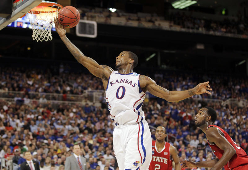 Kansas forward Thomas Robinson (0) shoots a layup during the first half of an NCAA tournament Midwest Regional college basketball game against North Carolina State, Friday, March 23, 2012, in St. Louis. (AP Photo/Jeff Roberson)