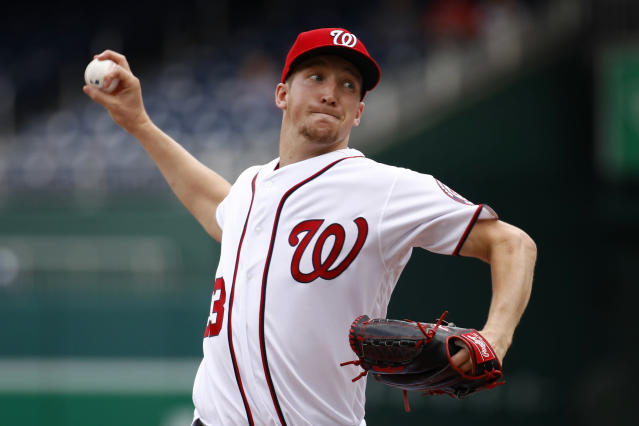 Washington Nationals starting pitcher Erick Fedde throws to the Colorado Rockies in the first inning of the first baseball game of a doubleheader, Wednesday, July 24, 2019, in Washington. (AP Photo/Patrick Semansky)