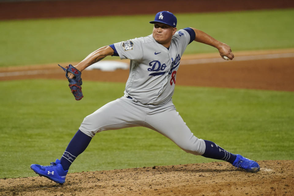 Los Angeles Dodgers pitcher Victor Gonzalez throws against the Tampa Bay Rays during the eighth inning in Game 5 of the baseball World Series Sunday, Oct. 25, 2020, in Arlington, Texas. (AP Photo/Eric Gay)
