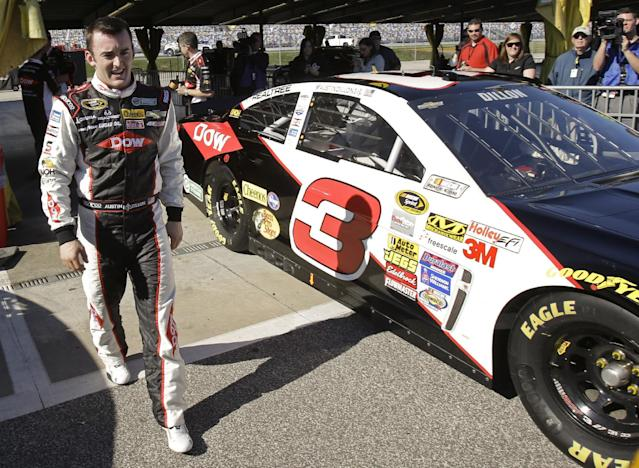 CORRECTS NAME TO DILLON NOT DILLION Austin Dillon walks by his car in the garage area after he won the pole position during qualifying for the Daytona 500 NASCAR Sprint Cup Series auto race at Daytona International Speedway in Daytona Beach, Fla., Sunday, Feb. 16, 2014. (AP Photo/John Raoux)