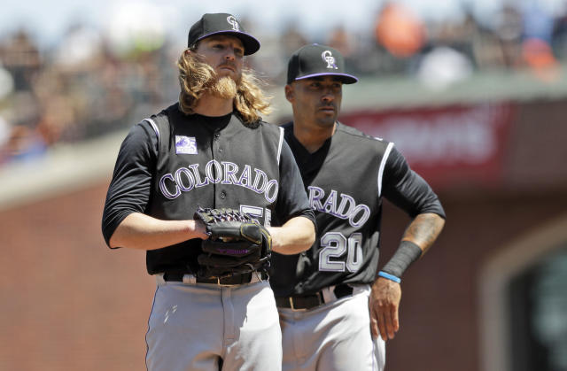 Colorado Rockies starting pitcher Jon Gray, left, stands on the mound next to teammate Ian Desmond (20) before being pulled from a baseball game during the fourth inning against the San Francisco Giants, Saturday, May 19, 2018, in San Francisco. (AP Photo/Marcio Jose Sanchez)