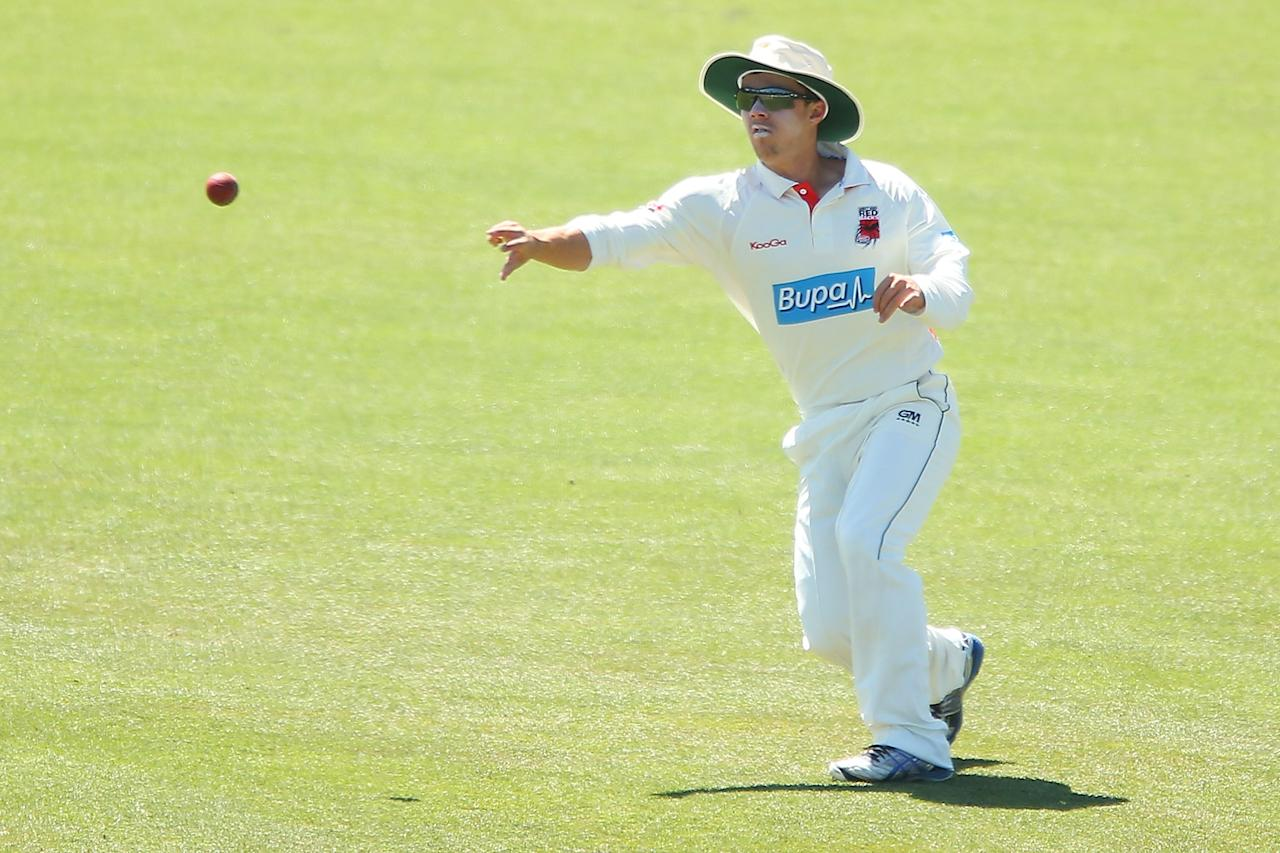 CANBERRA, AUSTRALIA - DECEMBER 08:  Travis Head of the Chairman's XI fields during day three of the international tour match between the Chairman's XI and Sri Lanka at Manuka Oval on December 8, 2012 in Canberra, Australia.  (Photo by Brendon Thorne/Getty Images)
