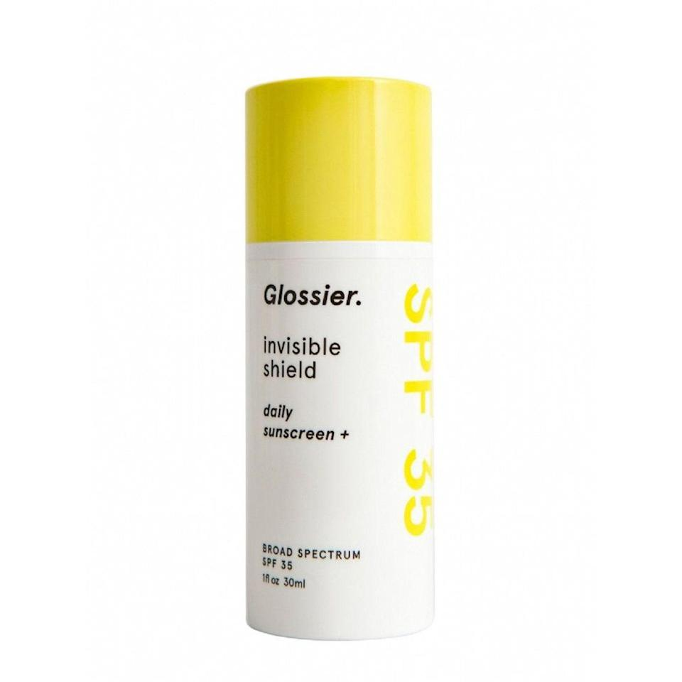 """A fan-favorite since it first launched, digital editor Jihan Forbes appreciates Glossier's Invisible Shield Daily Sunscreen SPF 35 because she says the colorless, silky formula never leaves her skin looking ashy. Commerce editor Nykia Spradley also recommends this water-gel formula, noting that it """"gives [her] partially oily skin a subtle mattified effect, which is ideal on a balmy summer day."""""""