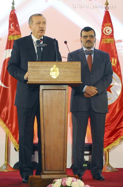Turkish Prime Minister Recep Tayyip Erdogan makes a statement during a joint press conference held with Tunisian Prime Minister Prime Minister Ali Larayedh, right, at the palace hotel in Gammarth, north of Tunis, Tunisia, Thursday, June 6, 2013. Turkish Prime Minister Recep Tayyip Erdogan on Thursday appeared to have slightly moderated his rhetoric regarding the anti-government protests in his country but didnít back away from redevelopment plans for Istanbul that sparked the nearly week-long unrest and claimed ìterrorist groupsî were involved in the unrest. (AP Photo/Hassene Dridi)