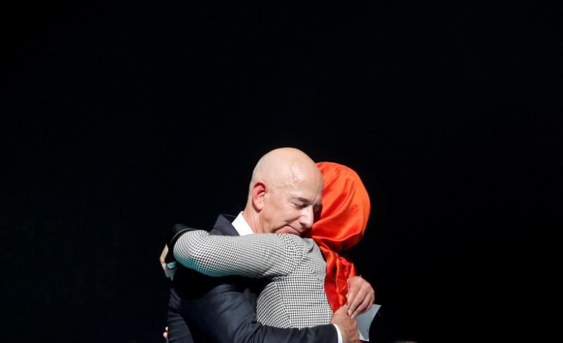 FILE PHOTO: Hatice Cengiz, fiancee of the murdered Saudi journalist Jamal Khashoggi and Jeff Bezos, founder of Amazon and Blue Origin, embrace each other as they attend a ceremony marking the first anniversary of Khashoggi's killing at the Saudi Consulate