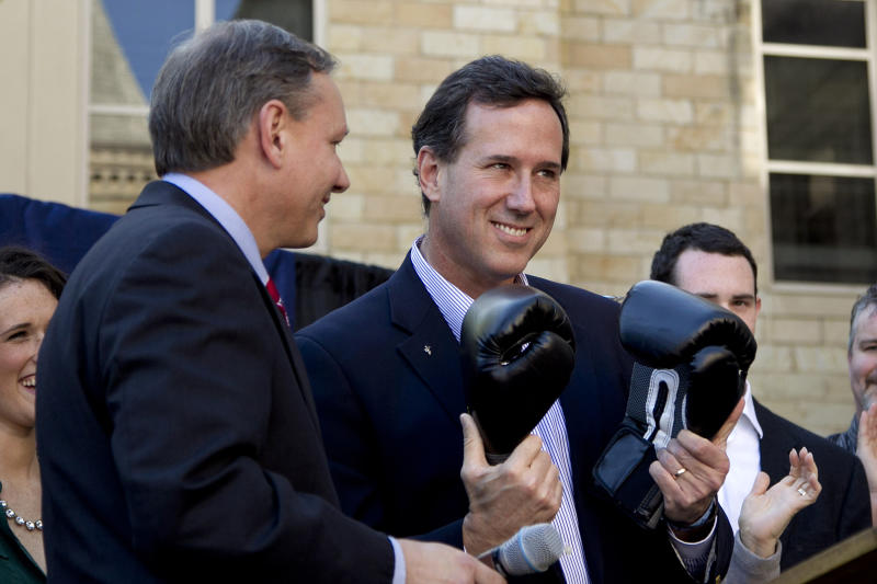 FILE - In this April 4, 2012 file photo, Republican presidential candidate, former Pennsylvania Sen. Rick Santorum, center, holds a pair of boxing gloves at a campaign stop in Hollidaysburg, Pa. Santorum is as unpopular in Pennsylvania today as he was six years ago, when home-state voters kicked him out of the Senate in a rout. That sour public perception may doom his fading chances of sticking around in the GOP presidential race, along with other hurdles that dot his path to a possible, and needed, victory in the April 24 primary. (AP Photo/Jae C. Hong, File)