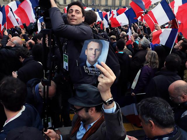<p>Supporters celebrate at a rally for French president-elect Emmanuel Macron, outside the Louvre in Paris, May 7, 2017. (Gyori Antoine /Corbis via Getty Images) </p>
