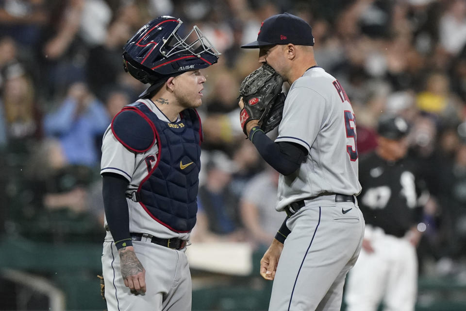 Cleveland Indians relief pitcher Blake Parker, right, talks with catcher Roberto Perez during the fifth inning of a baseball game against the Chicago White Sox in Chicago, Friday, July 30, 2021. (AP Photo/Nam Y. Huh)