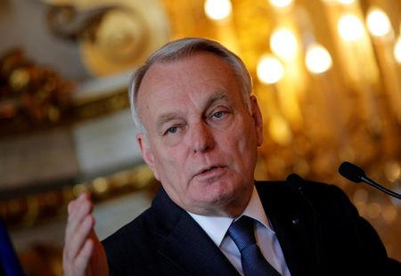French Foreign Minister Jean-Marc Ayrault delivers his speech during a press conference in Paris