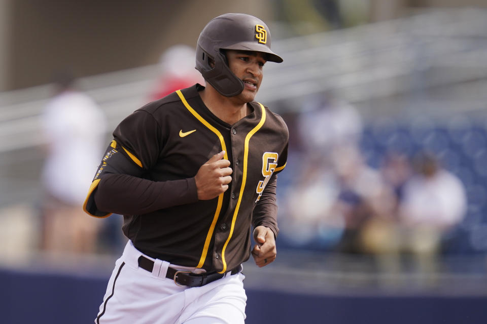San Diego Padres' Trent Grisham runs the bases after hitting a home run in a spring training baseball game against the Kansas City Royals, Sunday, March 7, 2021, in Peoria, Ariz. (AP Photo/Sue Ogrocki)
