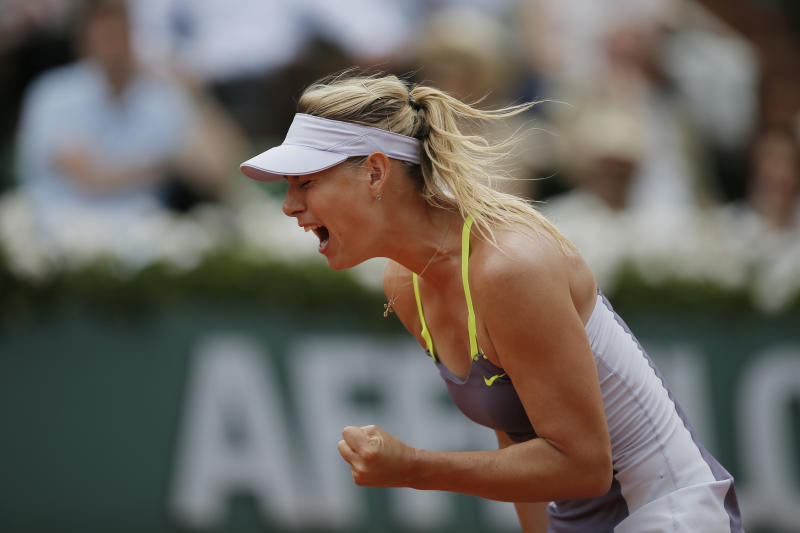 Russia's Maria Sharapova clenches her fist after scoring against Victoria Azarenka of Belarus, defeating Azarenka in three sets 6-1, 2-6, 6-4, in their semifinal match at the French Open tennis tournament, at Roland Garros stadium in Paris, Thursday June 6, 2013. (AP Photo/Petr David Josek)