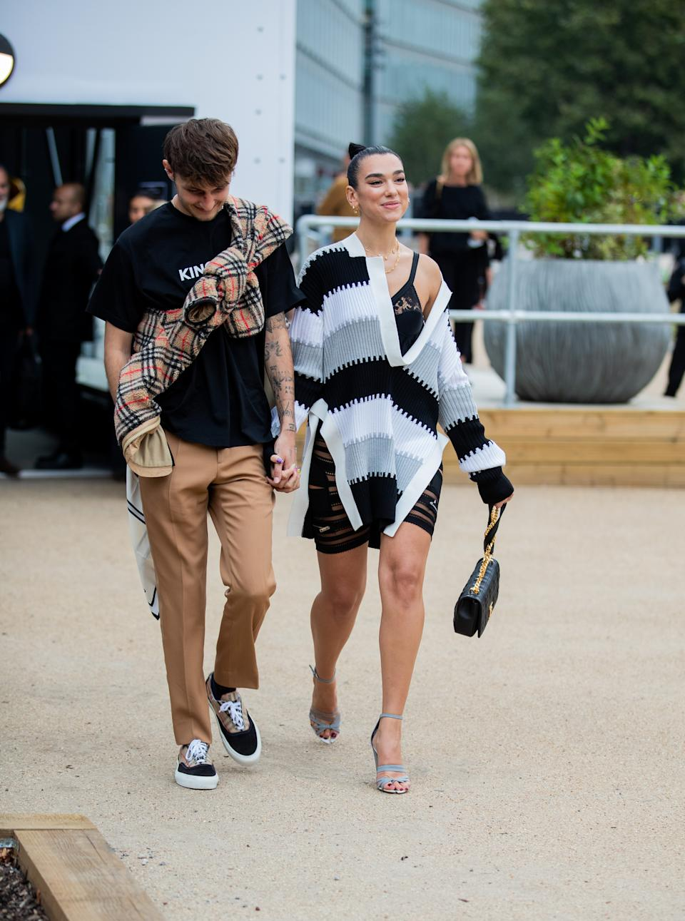 Anwar Hadid and Dua Lipa arriving at Burberry's SS20 show. [Photo: Getty Images]