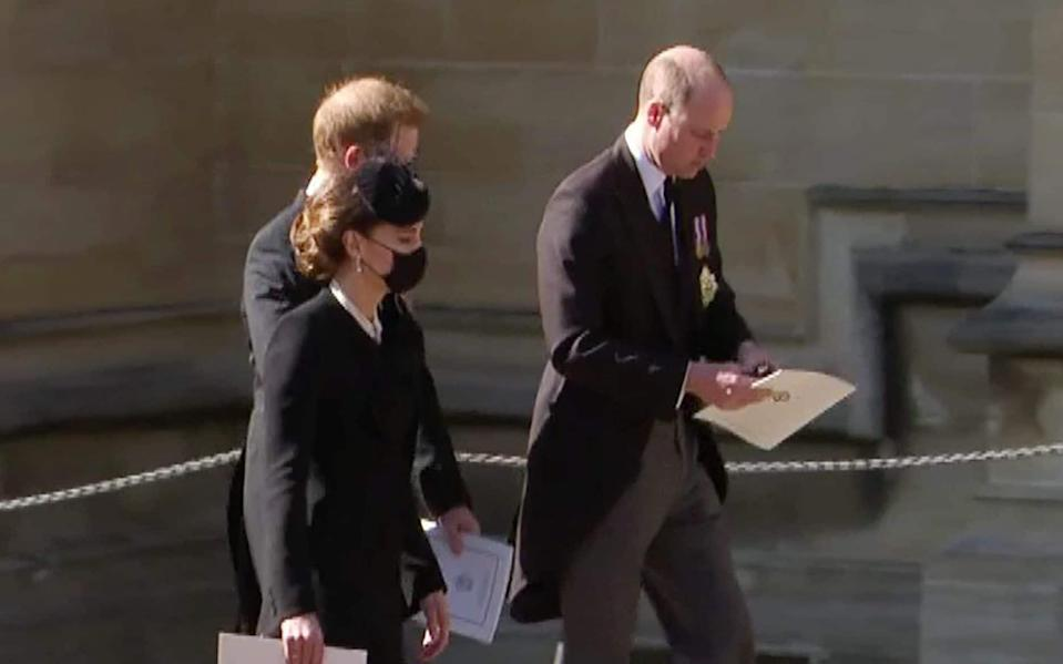 Moments after leaving the funeral service, Kate walked with William and Harry, gradually stepping back and allowing them to talk - pixel GRG