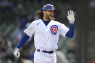 Chicago Cubs' Jake Marisnick celebrates at the dugout after hitting a solo home run during the fourth inning of a baseball game against the Milwaukee Brewers, Friday, April 23, 2021, in Chicago. (AP Photo/Paul Beaty)