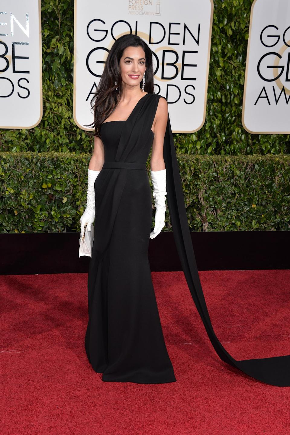 """<strong><h2>2015</h2></strong><br>Wearing black on the red carpet is hardly groundbreaking, but Amal Clooney has a way of standing out in a crowd, especially when she's donning head-to-toe Dior Haute Couture.<br><br><em>Amal Clooney in Dior Haute Couture.</em><span class=""""copyright"""">Photo: George Pimentel/WireImage.</span>"""
