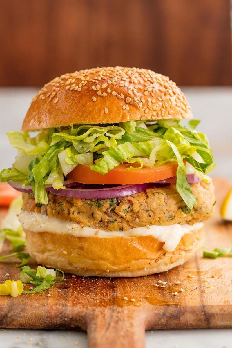 """<p>A great burger is so much more than just beef and these 5-star salmon burgers are here to prove it. They are simple, quick, and insanely satisfying. Using canned salmon means you can stock your pantry and you won't even need to go to the shop when the craving hits! </p><p>Get the <a href=""""https://www.delish.com/uk/cooking/recipes/a29204817/homemade-salmon-burgers-recipe/"""" rel=""""nofollow noopener"""" target=""""_blank"""" data-ylk=""""slk:Salmon Burger"""" class=""""link rapid-noclick-resp"""">Salmon Burger</a> recipe.</p>"""