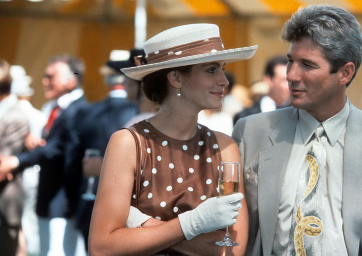 Julia Roberts has a drink with Richard Gere in a scene from the film 'Pretty Woman', 1990. (Photo by Buena Vista/Getty Images)