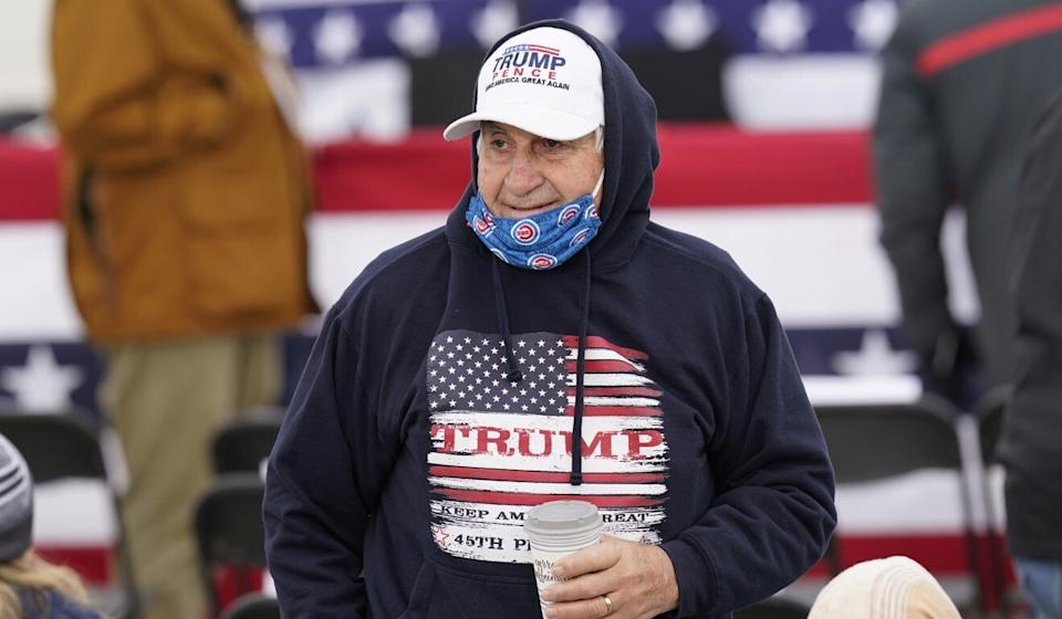 A Trump supporter waits to hear Vice-President Mike Pence speak at an airport rally in Des Moines, Iowa, on Thursday. Photo: AP