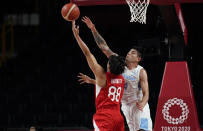 Japan's Tenketsu Harimoto (88) and Argentina's Luis Scola (4) reach for a rebound during men's basketball preliminary round game at the 2020 Summer Olympics, Sunday, Aug. 1, 2021, in Saitama, Japan. (AP Photo/Eric Gay)