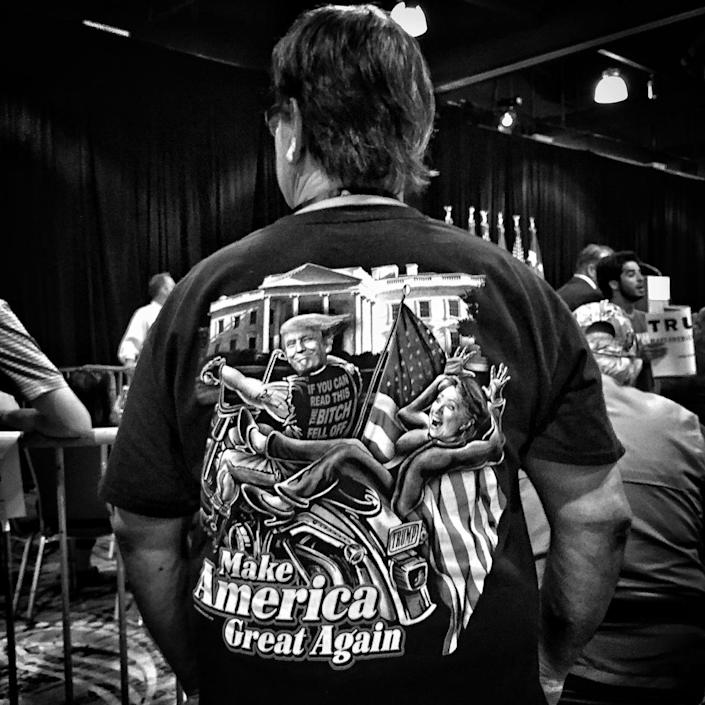 <p>A man wears a T-shirt featuring Donald Trump and Hillary Clinton ahead of a Trump rally, June 17, the Woodlands, Texas. (Photo: Holly Bailey/Yahoo News) </p>