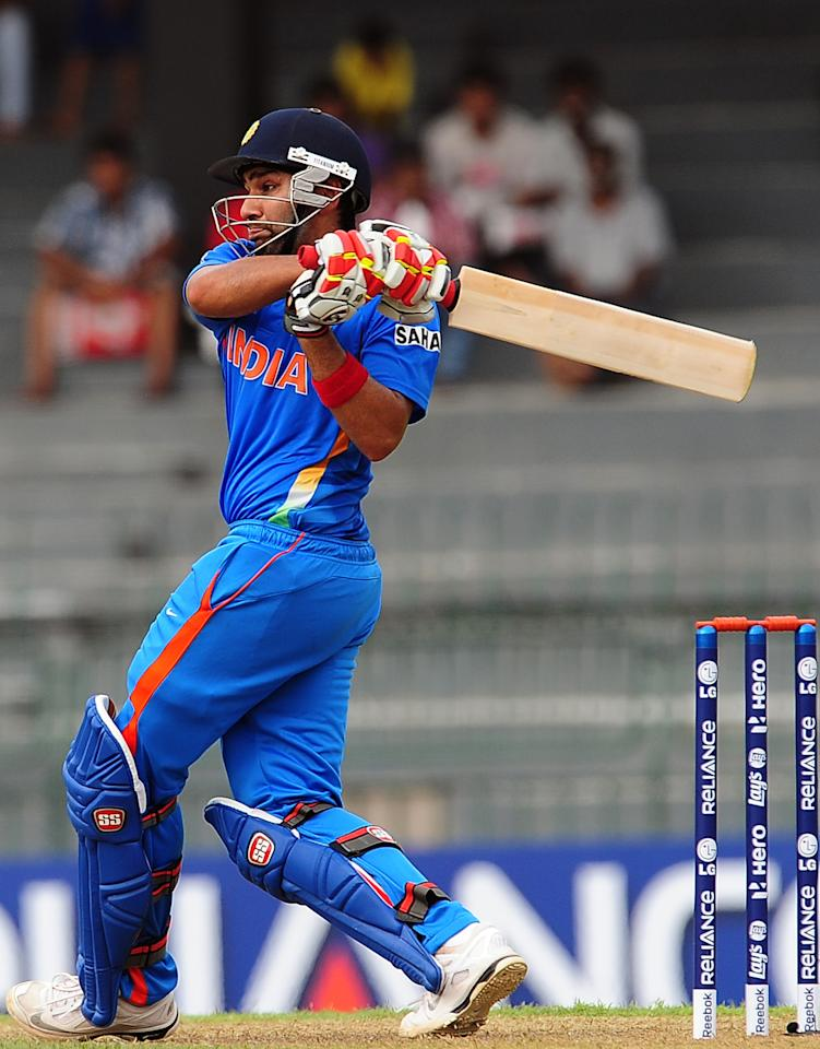 Indian cricketer Rohit Sharma plays a shot during a World Twenty20 warm-up match between India and Pakistan at The R. Premadasa Cricket Stadium in Colombo on September 17, 2012. AFP PHOTO/ LAKRUWAN WANNIARACHCHI