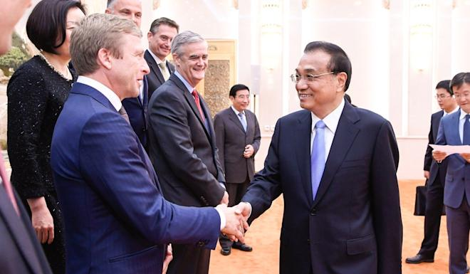 Chinese Premier Li Keqiang, shown in Beijing on Friday meeting with members of an international consultive committee on advanced manufacturing, has been encouraging more foreign investment. Photo: Xinhua