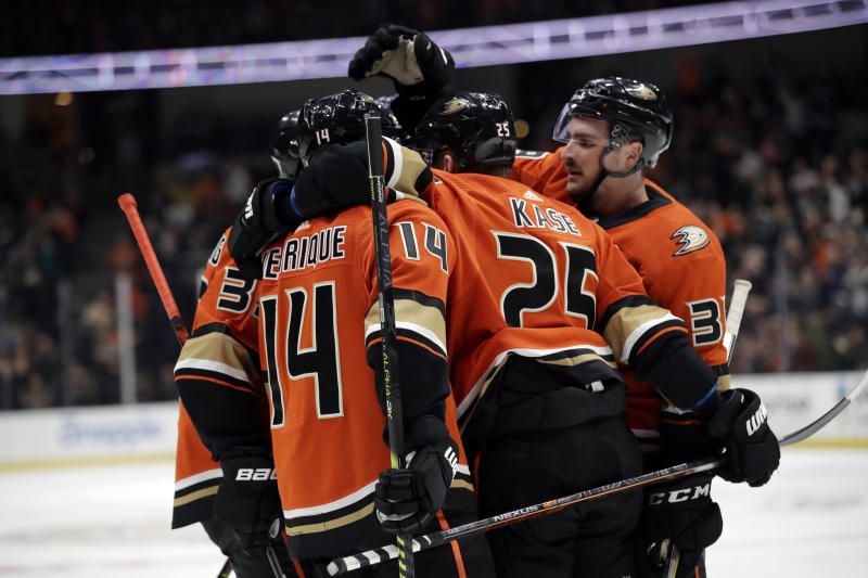 Anaheim Ducks' Adam Henrique (14) celebrates his goal with teammates during the second period of an NHL hockey game against the Vegas Golden Knights on Friday, Dec. 27, 2019, in Anaheim, Calif. (AP Photo/Marcio Jose Sanchez)