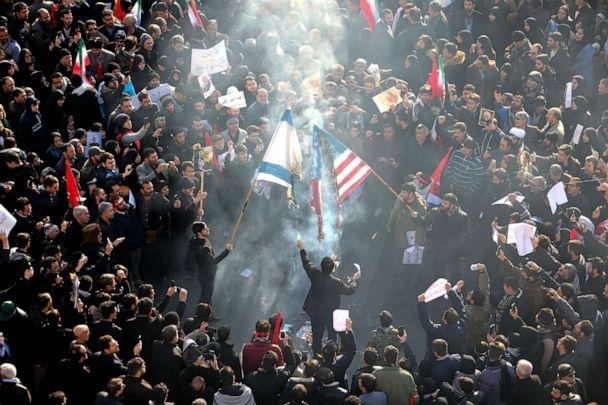 PHOTO: Iranians set U.S. and Israeli flags on fire during a funeral procession organised to mourn the slain military commander Qasem Soleimani, Iraqi paramilitary chief Abu Mahdi al-Muhandis and others in the capital Tehran on Jan. 6, 2020. (Atta Kenare/AFP via Getty Images)