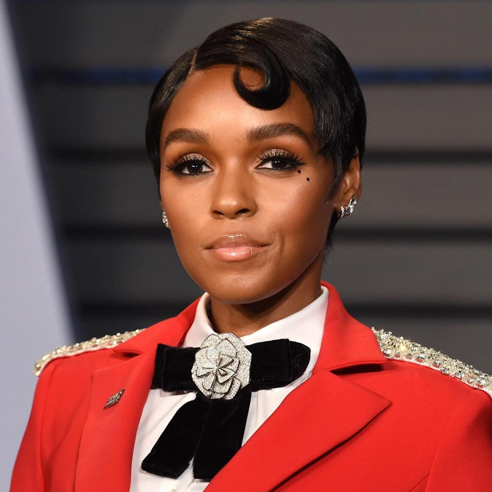 """Daring to try something different for your nuptials? Take a page out of Janelle Monáe's book and go for a swirled bang. """"This style is easier to control in heat and humidity,"""" says Gallagher. """"And the swoop in the front creates a bit of interest."""" As for your outfit, he suggests something with a symmetrical, soft silhouette. For the bolder types: pair the hair with an unexpected element like a blazer, cape, or garment adorned with embellishments."""