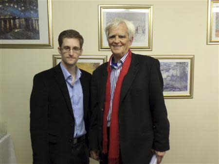 German Greens lawmaker Stroebele poses for a picture with fugitive former U.S. spy agency contractor Snowden in an undisclosed location in Moscow