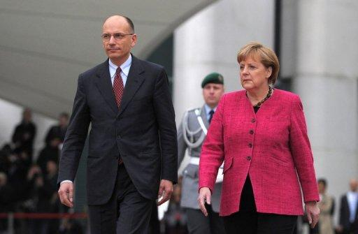 Italy's Letta to juggle demands of EU and parties
