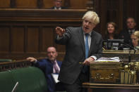 In this handout photo provided by UK Parliament, Britain's Prime Minister Boris Johnson speaks during Prime Minister's Questions in the House of Commons in London, Wednesday, Sept. 16, 2020. U.K. lawmakers have criticized the government's handling of the COVID-19 testing crisis for a second day as opposition leaders say Prime Minister Boris Johnson lacked a cohesive plan to tackle the virus as the country faces a second wave in the pandemic. (Jessica Taylor/UK Parliament via AP)