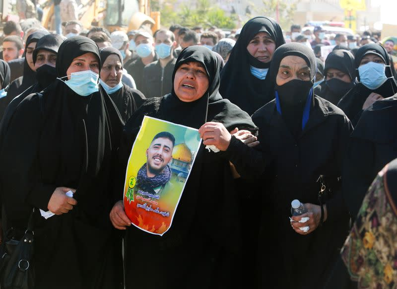 Mother of Mohamed Tahan, who was killed at the border fence with Israel yesterday, reacts during his funeral, in Adloun