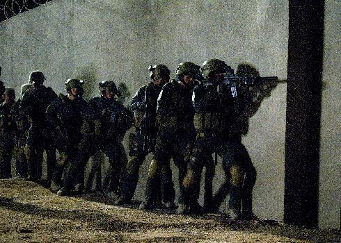 """This film image released by National Geographic Channels shows actors portraying members of SEAL Team Six who raided the compound of Osama Bin Laden in """"SEAL Team Six: The Raid on Osama bin Laden."""" The TV film premieres on Nov. 4. (AP Photo/National Geographic Channels, Geronimo Nevada, LLC.)"""