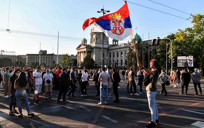 Protesters gather outside Serbia's National Assembly building - ANDREJ ISAKOVIC/AFP