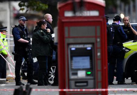 Emergency services personnel gather near the Natural History Museum, after a car mounted the pavement, in London, Britain October 7, 2017. REUTERS/Dylan Martinez