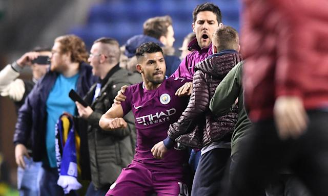 Sergio Agüero reacts after being confronted by a Wigan supporter following Manchester City's FA Cup fifth-round defeat at the DW Stadium on Monday night.