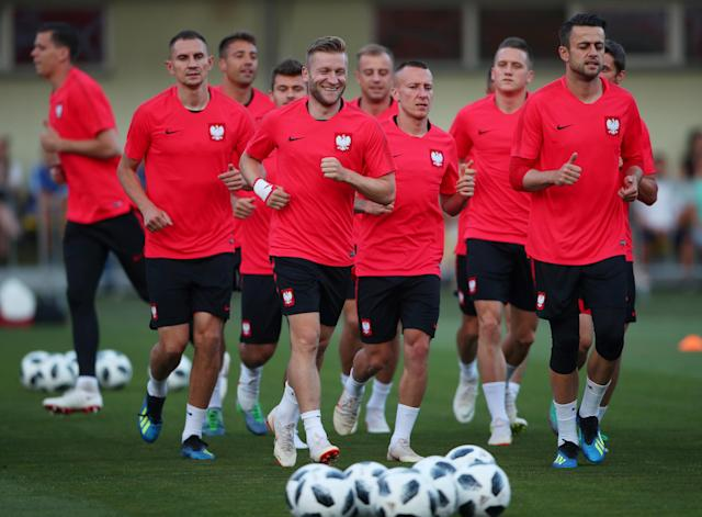 Soccer Football - World Cup - Poland Training - Sputnik Stadium, Sochi, Russia - June 13, 2018 Poland's Jakub Blaszczykowski, Lukasz Fabianski and team mates during training REUTERS/Hannah McKay