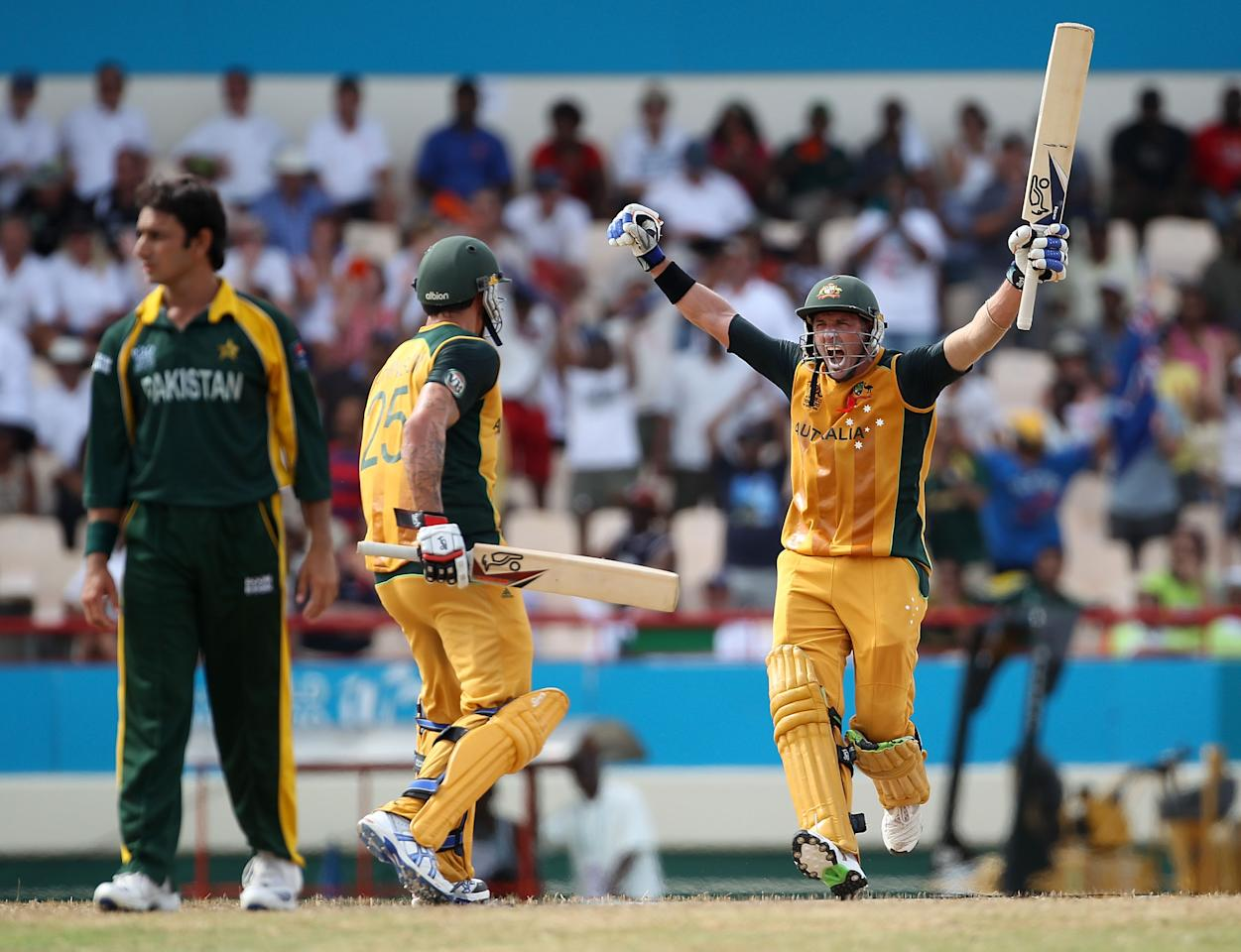 GROS ISLET, SAINT LUCIA - MAY 14:  Michael Hussey of Australia celebrates hitting the winning runs with Mitchell Johnson during the ICC World Twenty20 semi final between Australia and Pakistan at the Beausjour Cricket Ground on May 14, 2010 in Gros Islet, Saint Lucia.  (Photo by Clive Rose/Getty Images)